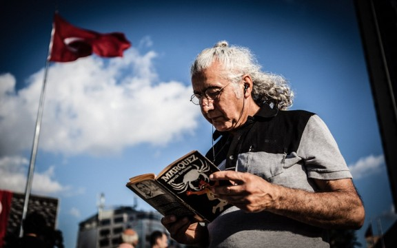 A man reads Gabriel García Márquez's La Hojarasca (Yaprak Firtinasi in Turkish and Leaf Storm in English), a collection of short stories, in Taksim Square, Istanbul.
